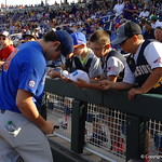 Florida Gators players sign autographs before game one of the College World Series.