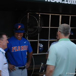 Florida Gators coach Kevin O'Sullivan meets with SEC commissioner Greg Sankey before game one of the College World Series.