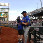 Florida Gators coach Kevin O'Sullivan and his son before game one of the College World Series finals.