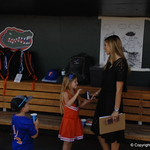 ESPN's Laura Rutledge with Florida Gators coach Kevin O'Sullivan's son and daughter.