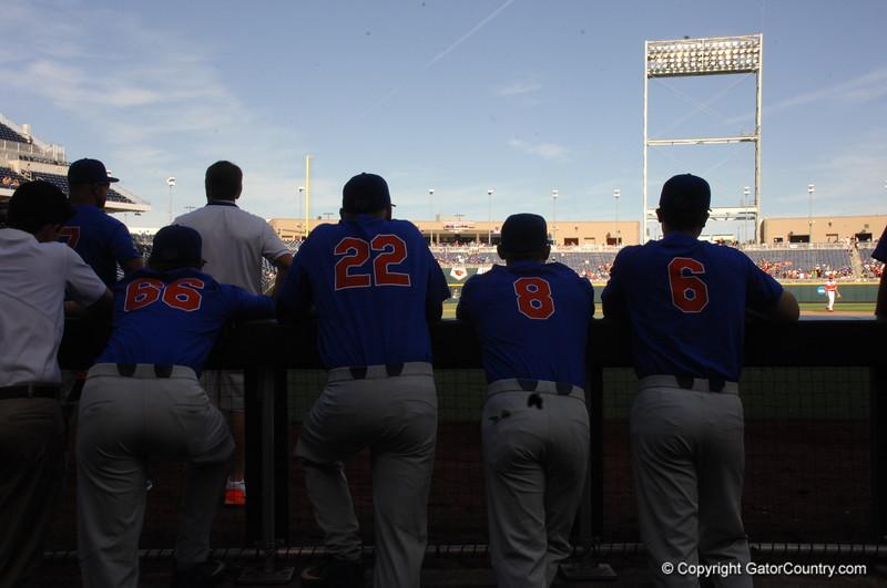 Ryan Larson, JJ Schwarz, Deacon Liput and JOnathan India watch Louisville take infield outfield