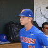 Brady Singer walks around in the dugout before heading to the bullpen to warm up for his start.