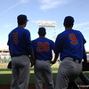 Deacon Liput, Mark Kolozsvary and Christian Hicks watch Louisville take infield outfield.