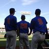 Deacon Liput, Mark Kolozsvary and Christian Hicks watch Louisville take infield outfield.