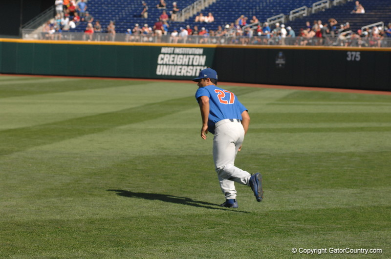 Nelson Maldonado gets his sprained ankle loose with some light running before the game.