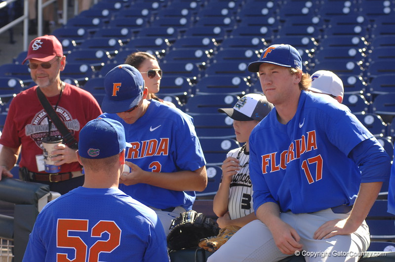 Florida Gators pitcher Garrett Milchin signs a baseball for a fan. Michael Byrne ponders life.