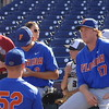 Florida Gators pitcher Garrett Milchin signs a baseball for a fan. Michael Byrne ponders life.