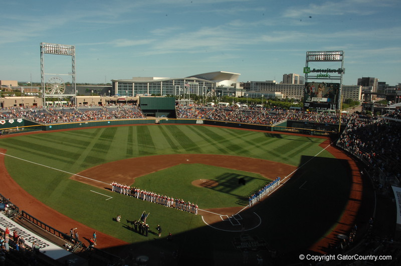 The Florida Gators and Louisville Cardinals stand for the National Anthem before their game in the 2017 College World Series.