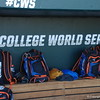 The Florida Gators bags sit inside the first base dugout at TD Ameritrade Park