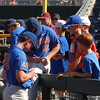 Florida Gators pitchers Nate Brown and Tyler Dyson signs a baseball for a fan before the Gators game against Louisville.