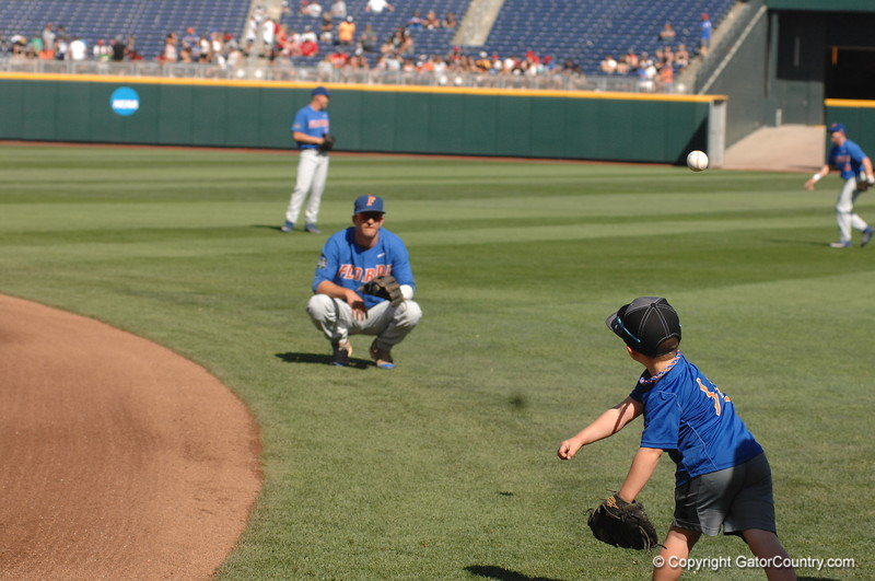 Dalton Guthrie plays catch with Finn O'Sullivan.