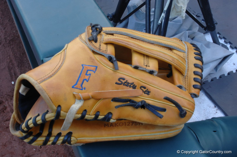 Ryan Larson's glove with his number (66) written out.