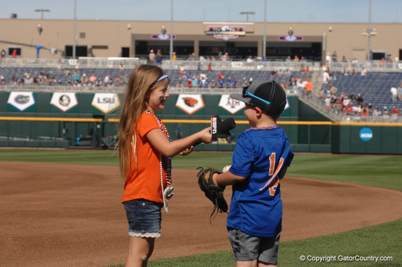 Payton O'Sullivan interviewing her brother Finn with Laura Rutledge's ESPN microphone.