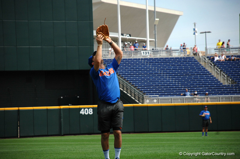 Jonathan India field a pop fly during the Florida Gators practice at TD Ameritrade.