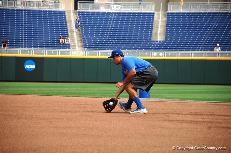 Freshman Keenan Bell fields a ground ball during drills.