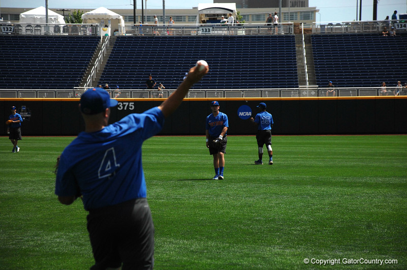 Mike Rivera and Deacon Liput warming up before the Florida Gators practice at the College World Series.