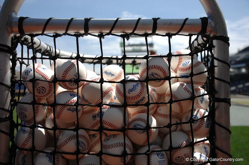 Baseballs wait at TD Ameritrade Park before the Florida Gators take batting practice at the College World Series.