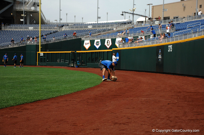 Nick Horvath fields a ball off the wall at TD Ameritrade Park.