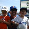 Florida Gators manager Kevin O'Sullivan poses for a photo with his daughter Payton and son Finn before practice.
