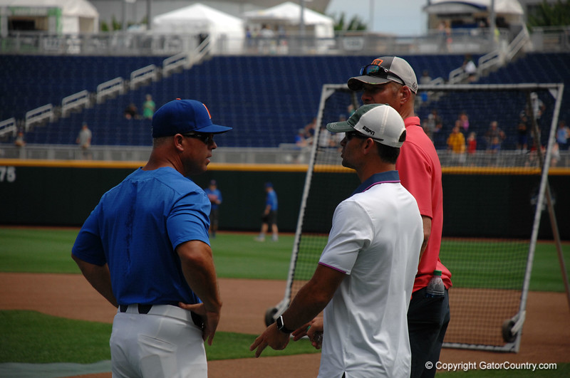 Florida Gators manager Kevin O'Sullivan chats with ESPN's Chris Davis during the Florida Gators practice at TD Ameritrade.