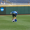 David Lee snags a ball with a bucket while running in the outfield during batting practice.