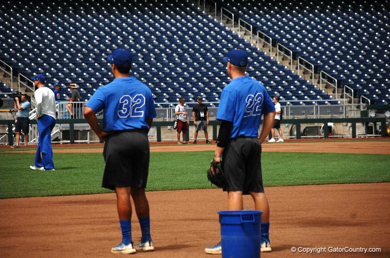 Freshman Keenan Bell (32) and junior JJ Schwarz (22) during infield drills.