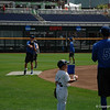 Finn O'Sullivan gives Dalton Guthrie throwing tips while the Gators' shortstop plays catch with Blake Reese.