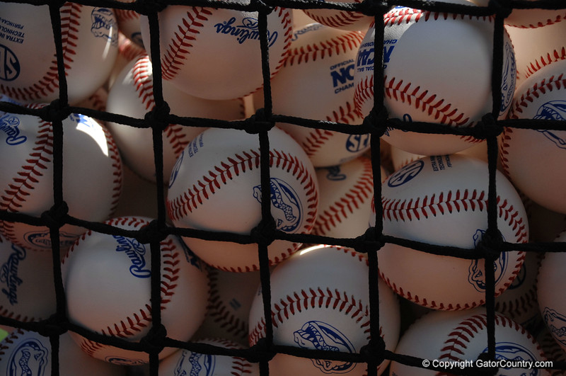Baseballs wait at TD Ameritrade Park before the Florida Gators take batting practice at the College World Series.