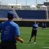 Freshman pitcher Garrett Milchin warming up with senior Frank Rubio.