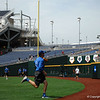 Florida Gators senior Ryan Larson goes back for a pop fly during practice.