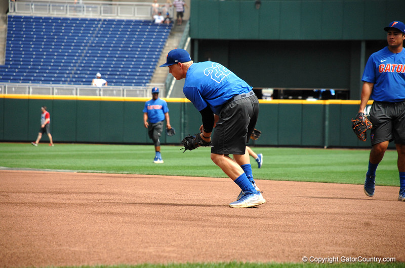 JJ Schwarz field a ground ball during practice.