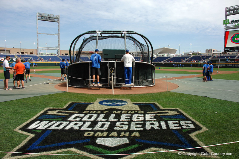 Christian Hicks and Lars Davis watch the Gators take batting practice at TD Ameritrade Park.