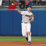 University of Florida Gators infielder Christian Hicks throwing to first base for a ground ball out as the Gators host and defeat the Florida State Seminoles 1-0 at McKethan Stadium. March 14th, 2017. Gator Country photo by David Bowie.