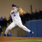 University of Florida Gators pitcher Tyler Dyson pitching in the ninth inning to close the game as the Gators host and defeat the Florida State Seminoles 1-0 at McKethan Stadium. March 14th, 2017. Gator Country photo by David Bowie.