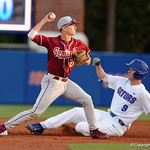 Florida State Seminoles infielder Matt Henderson tage second and throws to first for the double play as University of Florida Gators infielder Christian Hicks slides into second as the Gators host and defeat the Florida State Seminoles 1-0 at McKethan Stadium. March 14th, 2017. Gator Country photo by David Bowie.