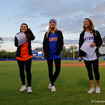 Three of the Florida Gator Cheerleaders come out to get the crowd pumped up as the Gators host and defeat the Florida State Seminoles 1-0 at McKethan Stadium. March 14th, 2017. Gator Country photo by David Bowie.