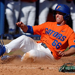 University of Florida Gators outfielder Ryan Larson rounds third and slides into home to put the Gators up 5-2 as the Gators sweep the series over the University of Miami Hurricanes with a 6-2 win at McKethan Stadium. February 26th, 2017. Gator Country photo by David Bowie.