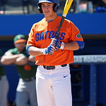 University of Florida Gators pitcher/OF Austin Langworthy looks to thrid base for the signal as the Gators sweep the series over the University of Miami Hurricanes with a 6-2 win at McKethan Stadium. February 26th, 2017. Gator Country photo by David Bowie.