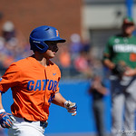 University of Florida Gators pitcher/OF Austin Langworthy runs down the first base line after being walked as the Gators sweep the series over the University of Miami Hurricanes with a 6-2 win at McKethan Stadium. February 26th, 2017. Gator Country photo by David Bowie.