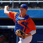 University of Florida Gators catcher JJ Schwarz throwing to second base during pre-game as the Gators sweep the series over the University of Miami Hurricanes with a 6-2 win at McKethan Stadium. February 26th, 2017. Gator Country photo by David Bowie.