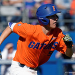 University of Florida Gators infielder Christian Hicks watching the ball flying through the air as he runs down the first base line as the Gators sweep the series over the University of Miami Hurricanes with a 6-2 win at McKethan Stadium. February 26th, 2017. Gator Country photo by David Bowie.