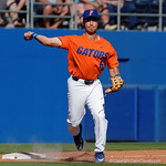 University of Florida Gators infielder Jonathan India fields a ground ball and throws to first base as the Gators sweep the series over the University of Miami Hurricanes with a 6-2 win at McKethan Stadium. February 26th, 2017. Gator Country photo by David Bowie.