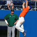 University of Florida Gators infielder Jonathan India leaps into the air to make the final out as the Gators sweep the series over the University of Miami Hurricanes with a 6-2 win at McKethan Stadium. February 26th, 2017. Gator Country photo by David Bowie.