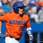 University of Florida Gators catcher JJ Schwarz running toward first base as the Gators sweep the series over the University of Miami Hurricanes with a 6-2 win at McKethan Stadium. February 26th, 2017. Gator Country photo by David Bowie.