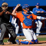 University of Florida Gators catcher JJ Schwarz throws back to the mound while the umpire gets jiggy with it as the Gators sweep the series over the University of Miami Hurricanes with a 6-2 win at McKethan Stadium. February 26th, 2017. Gator Country photo by David Bowie.