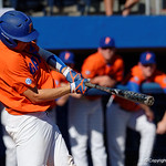 University of Florida Gators catcher JJ Schwarz swinging away as the Gators sweep the series over the University of Miami Hurricanes with a 6-2 win at McKethan Stadium. February 26th, 2017. Gator Country photo by David Bowie.