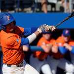 University of Florida Gators infielder Dalton Guthrie singles as the Gators sweep the series over the University of Miami Hurricanes with a 6-2 win at McKethan Stadium. February 26th, 2017. Gator Country photo by David Bowie.