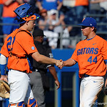University of Florida Gators catcher JJ Schwarz and University of Florida Gators pitcher Austin Langworthy celebrate as the Gators sweep the series over the University of Miami Hurricanes with a 6-2 win at McKethan Stadium. February 26th, 2017. Gator Country photo by David Bowie.