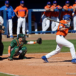University of Florida Gators infielder Christian Hicks singling as the Gators sweep the series over the University of Miami Hurricanes with a 6-2 win at McKethan Stadium. February 26th, 2017. Gator Country photo by David Bowie.