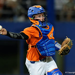 University of Florida Gators catcher Mark Kolozsvary fields a ground ball and throws to first base as the Gators fall 4-2 to the South Carolina Gamecocks at McKethan Stadium. April 21st, 2017. Gator Country photo by David Bowie.